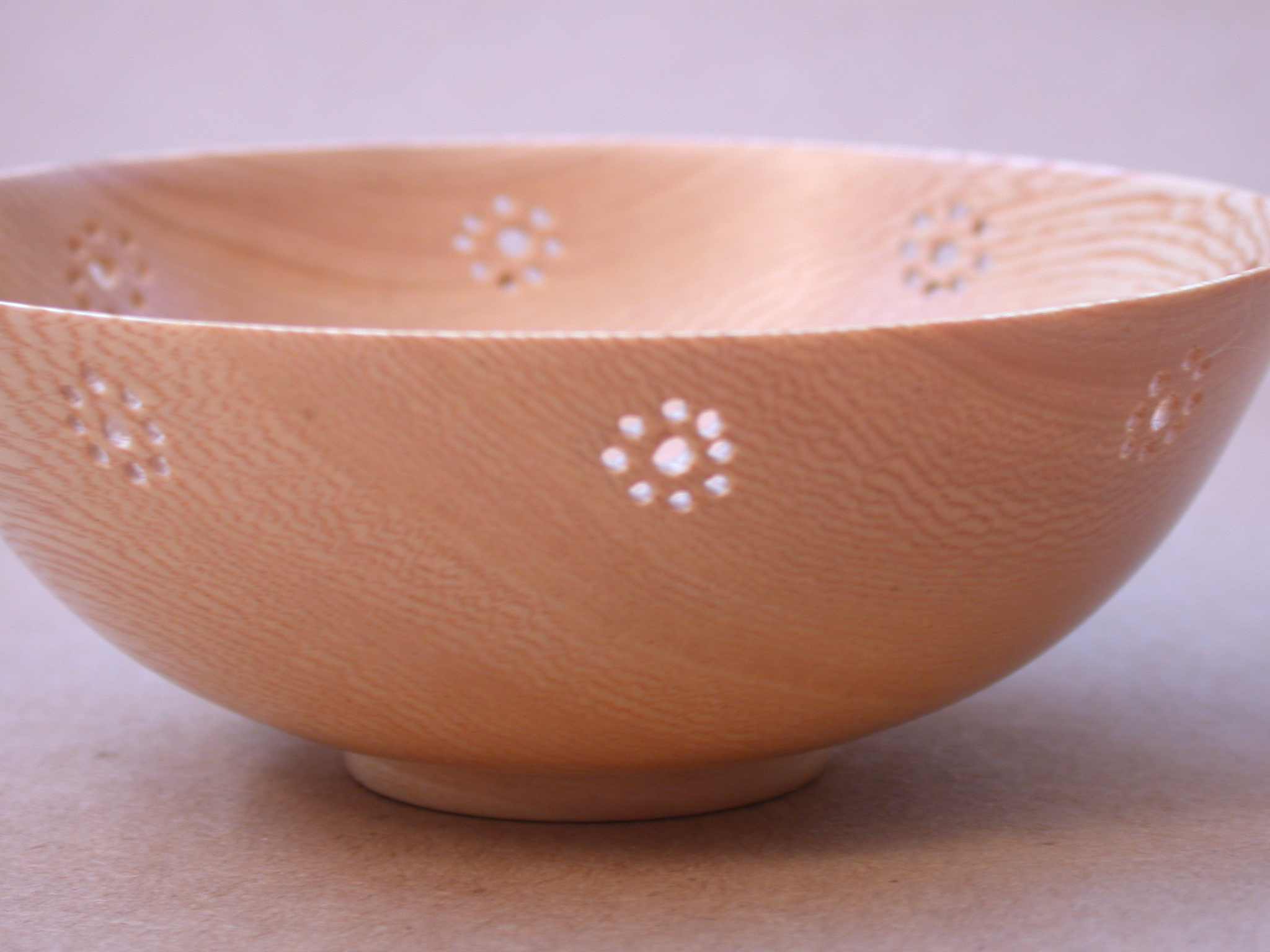 Turned bowl with flower pattern