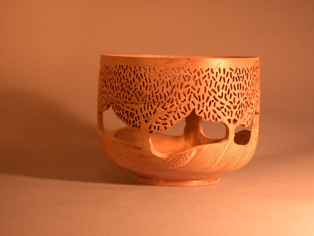 Turned bowl with piercings and detail work